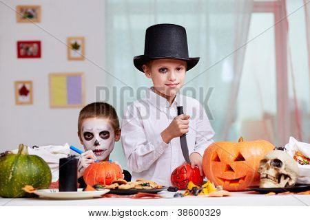 Photo of two eerie boys at Halloween table