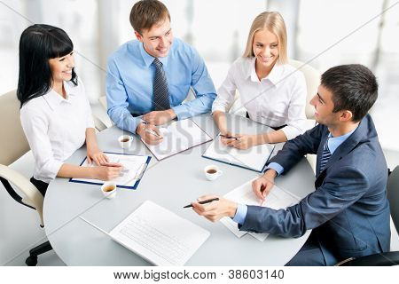 Image of businesspeople working at meeting