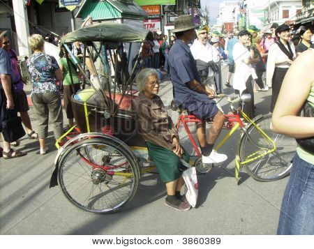 Old Woman On A Rickshaw