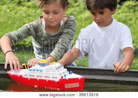 Children playing with boat