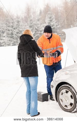 Woman handshake mechanic broken car snow help assistance winter man