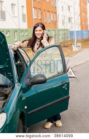 Woman on the phone for car help breakdown accident problem