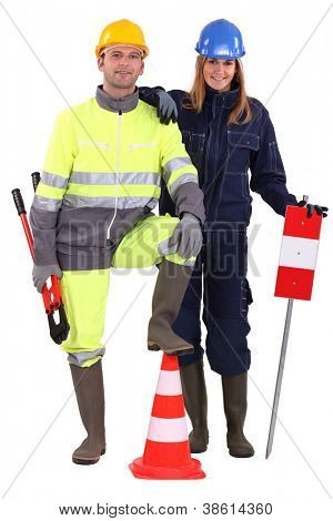 Construction crew with tools and warning signs
