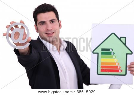 architect holding at sign and picture showing house with energy rating