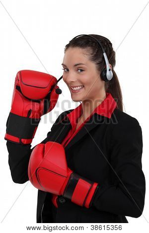 Telephonist wearing boxing gloves