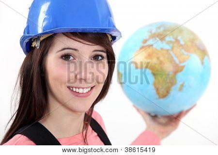 Tradeswoman holding a globe