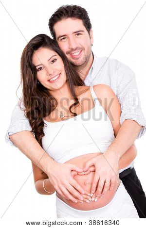Pregnant couple in love - isolated over a white background