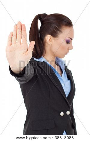 young business woman holding hand out to stop viewer. talk to the hand gesture looking away from the camera. isolated on white background