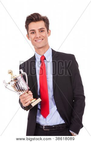 business man winner holding a cup trophy over white background