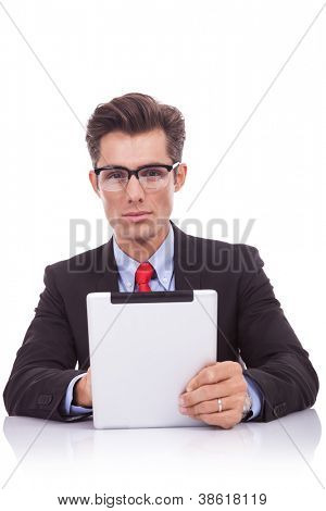 serious  business man holding an electronic tablet pad and looking to the camera