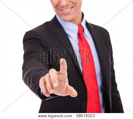 cut out image of a young business man pushing a button on white background