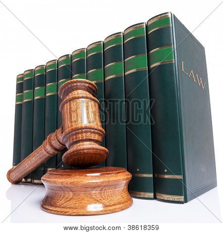 Judges wooden gavel and law books on white background