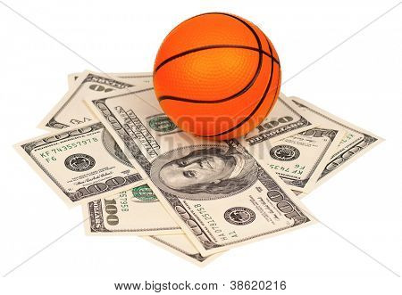 Small basketball ball on heap of dollars isolated on a white background