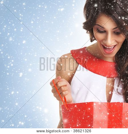 Young beautiful woman with some shopping bags