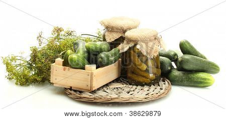 fresh cucumbers in wooden box, pickles and dill isolated on white