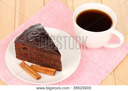 Chocolate sacher cake on wooden table