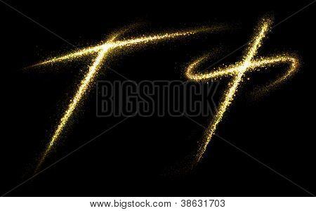 "Letter ""T"" of gold glittering stars dust trail (glittering font concept)"
