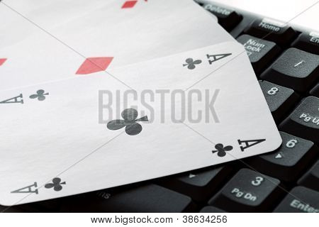 Cards over computer  keyboard. Concept of online card games.