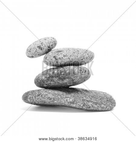 a pile of balanced zen stones on a white background