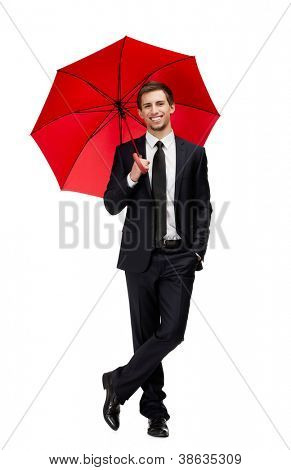 Full length portrait of businessman with opened opened umbrella, isolated on white