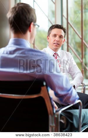 Man having an interview with manager employment job candidate hiring resume CEO work business