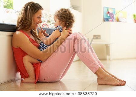 Mother Sitting With Daughter At Home