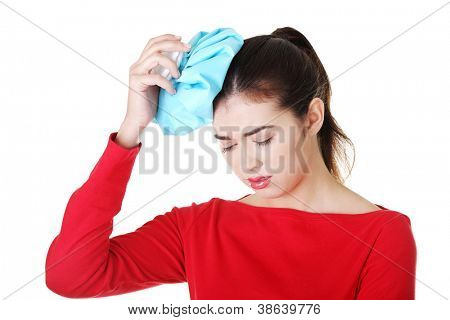 Woman with ice bag for headaches and migraines , isolated