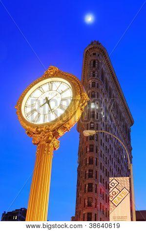 NEW YORK CITY, NY - DEC 30: Flatiron Building at night on December 30, 2011 in New York City. Flatiron building designed by Chicago's Daniel Burnham was designated a New York City landmark in 1966.