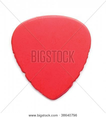 heavily worn and used Red guitar pick, isolated on white. Sides have notches from heavy string abrasion.