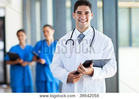 young medical doctor and staff in hospital