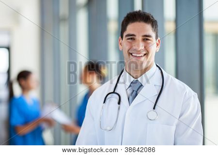 happy male medical doctor portrait in hospital