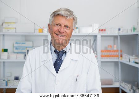 Smiling doctor in a hospital pharmacy