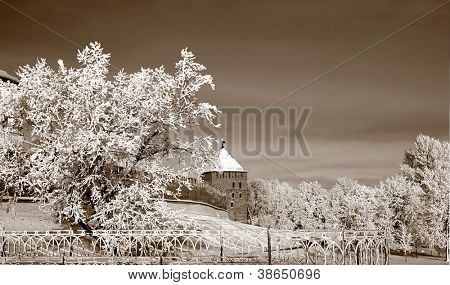 aging fortress amongst snow tree, sepia