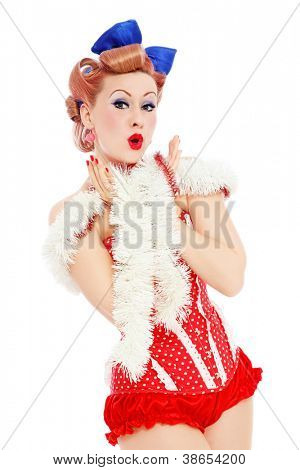 Young beautiful sexy surprised pin-up girl in red corset, over white background