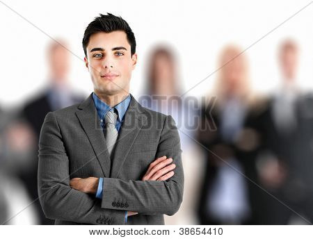 Portrait of an handsome businessman in front of his working team