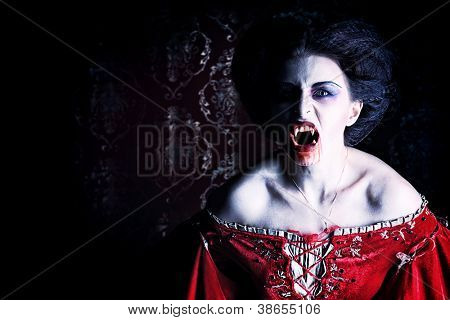 Close-up portrait of a bloodthirsty female vampire.