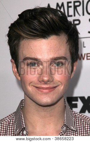 "LOS ANGELES - OCT 13:  Chris Colfer arrives at the ""American Horror Story: Asylum"" Premiere Screening at Paramount Theater on October 13, 2012 in Los Angeles, CA"