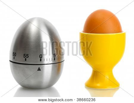egg timer and egg in orange stand isolated on white