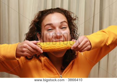 Young Funny Girl Eating Corn