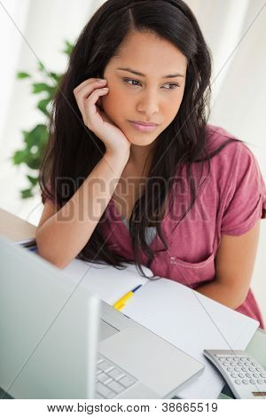 Bored brunette student at her desk