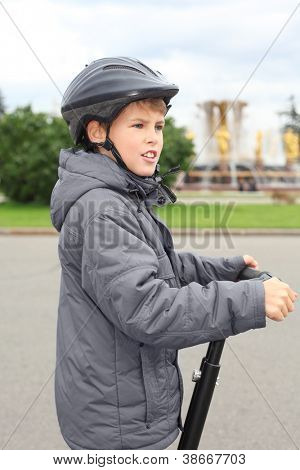 Little boy ride on segway near friendship fountain in Moscow, Russia, side