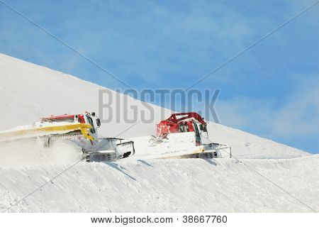Machines for skiing slope work