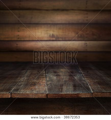 Old wooden table with wooden background