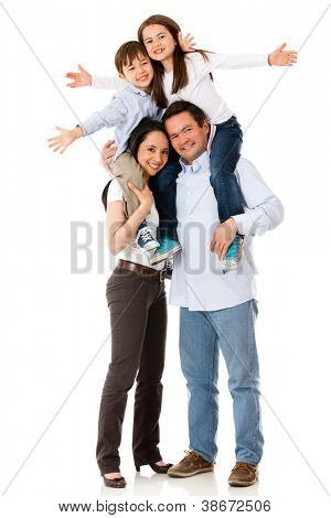 Family with arms up looking very happy - isolated over white