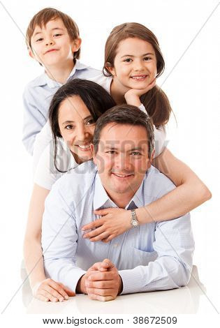 Loving family together looking very happy - isolated over white