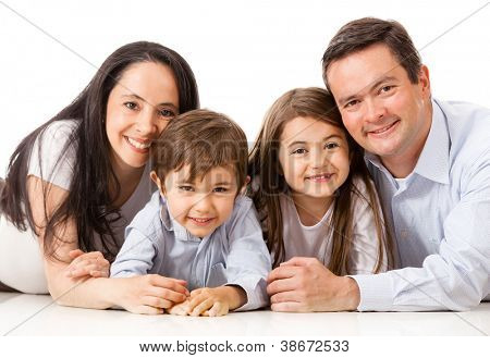 Family lying on the floor together - isolated over white