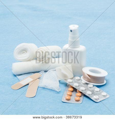 Content of First aid kit plasters, bandage and pills