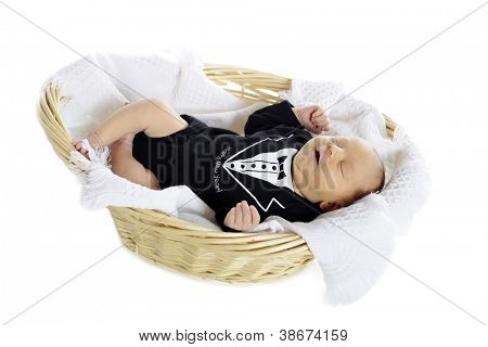 A handsome newborn in a blanket lined basket, wearing a tux with the message