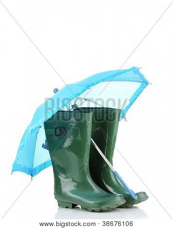 green gumboots and umbrella isolated on white