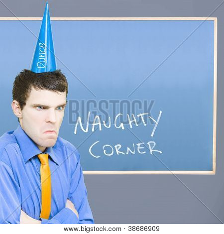 Businessman In Trouble Sitting In Naughty Corner